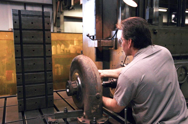 Man working on silver electric motor